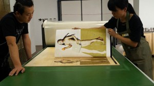 Transferring image on the wood plate. Masters for printing woodcut: Wang Yulin & Chen Kong Yue