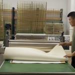 Artist Wu Bin helps with printing