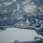 Frozen rivers and lakes in North of Russia in the evening